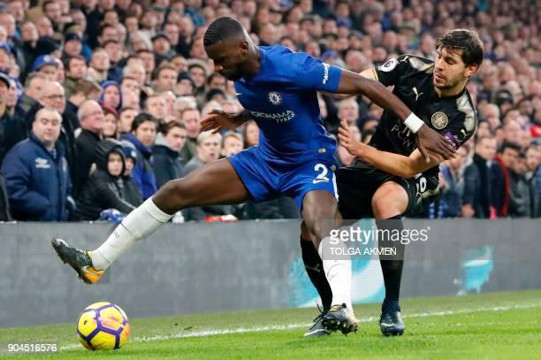 Leicester City's Austrian defender Aleksandar Dragovic pressures Chelsea's German defender Antonio Rudiger during the English Premier League football...