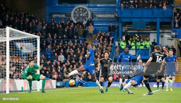 Leicester City's Austrian defender Aleksandar Dragovic shoots to see his shot saved by Chelsea's Belgian goalkeeper Thibaut Courtois during the...