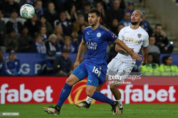 Leicester City's Austrian defender Aleksandar Dragovic vies with Leeds United's English striker Kemar Roofe during the English League Cup fourth...