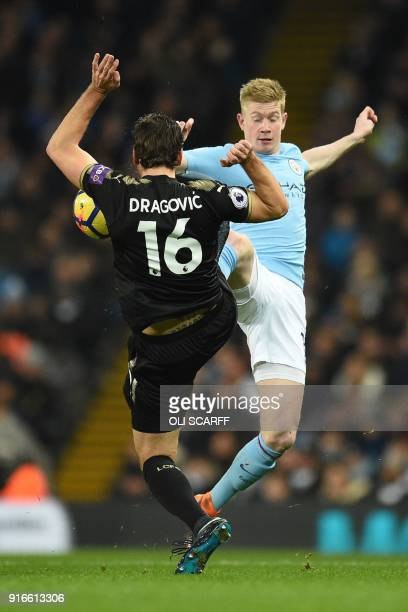 Leicester City's Austrian defender Aleksandar Dragovic vies with Manchester City's Belgian midfielder Kevin De Bruyne during the English Premier...