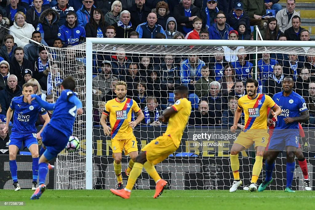 Leicester City's Austrian defender Christian Fuchs (2nd L) shoots to score their third goal during the English Premier League football match between Leicester City and Crystal Palace at King Power Stadium in Leicester, central England on October 22, 2016. / AFP / Ben STANSALL / RESTRICTED TO EDITORIAL USE. No use with unauthorized audio, video, data, fixture lists, club/league logos or 'live' services. Online in-match use limited to 75 images, no video emulation. No use in betting, games or single club/league/player publications. /