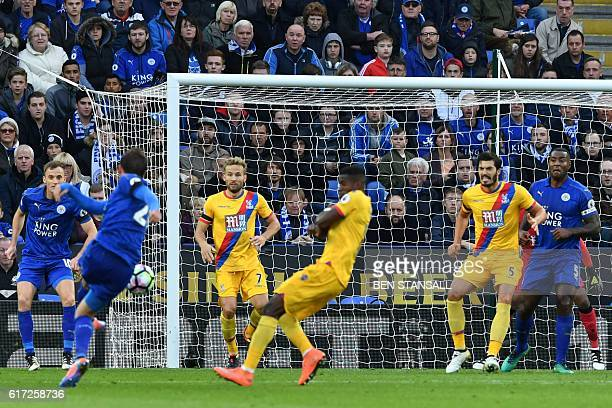 Leicester City's Austrian defender Christian Fuchs shoots to score their third goal during the English Premier League football match between...