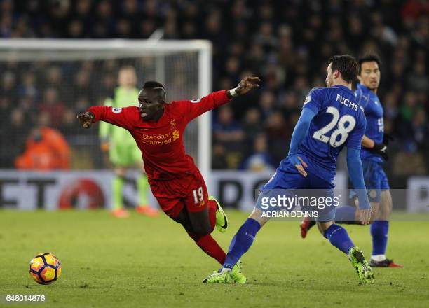 Leicester City's Austrian defender Christian Fuchs vies with Liverpool's Senegalese midfielder Sadio Mane during the English Premier League football...
