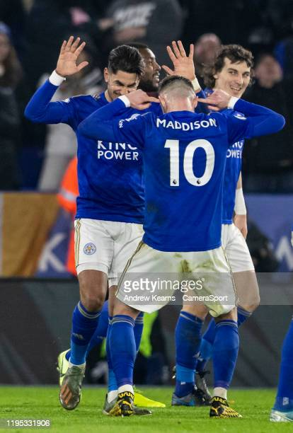 Leicester City's Ayoze Perez celebrates scoring his side's fourth goal with team mate James Maddison during the Premier League match between...