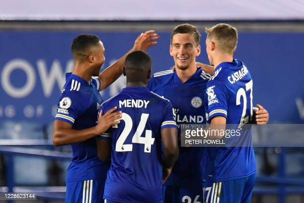 Leicester City's Belgian defender Dennis Praet celebrates after scoring their fourth goal during the English Premier League football match between...