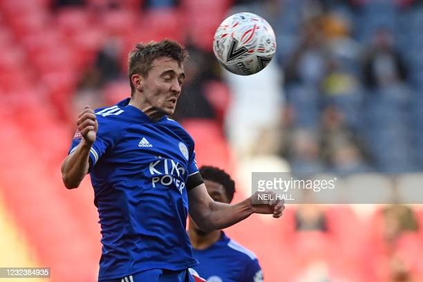 Leicester City's Belgian defender Timothy Castagne heads the ball during the English FA Cup semi-final football match between Leicester City and...