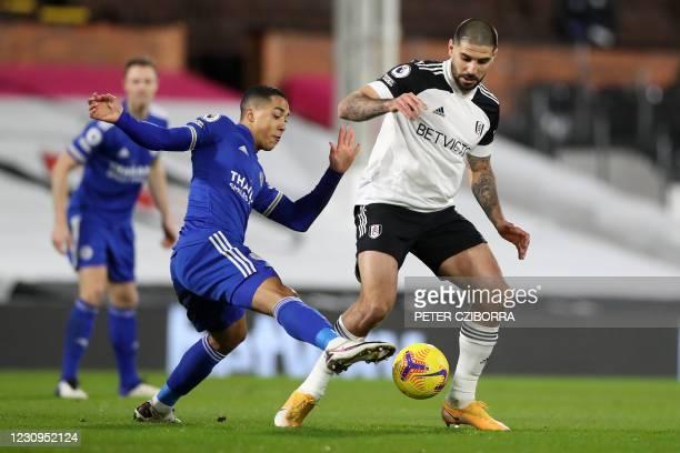 Leicester City's Belgian midfielder Youri Tielemans tackles Fulham's Serbian striker Aleksandar Mitrovic during the English Premier League football...