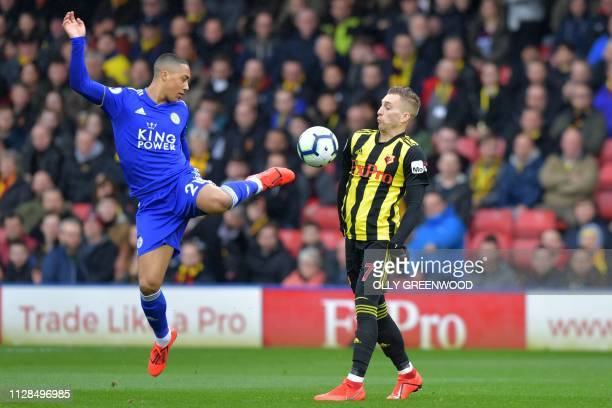 Leicester City's Belgian midfielder Youri Tielemans vies with Watford's Spanish midfielder Gerard Deulofeu during the English Premier League football...