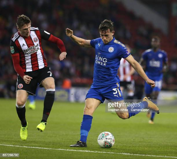 Leicester City's Ben Chilwell shoots past Sheffield United's John Lundstram during the Carabao Cup Second Round match between Sheffield United and...