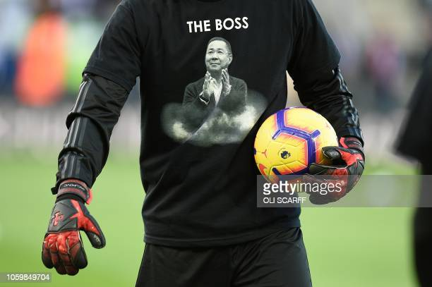 Leicester City's Bosnianborn Swiss goalkeeper Eldin Jakupovic wears a tshirts in memory of Leicester City's late Thai chairman Vichai...