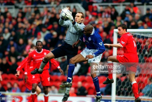 Leicester City's Brian Deane jumps for the ball with Middlesbrough's goalkeeper Mark Schwarzer as Gareth Southgate looks on