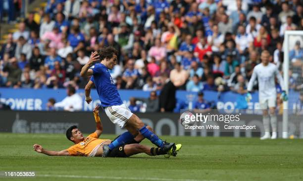 Leicester City's Caglar Soyuncu is tackled by Wolverhampton Wanderers' Raul Jimenez during the Premier League match between Leicester City and...