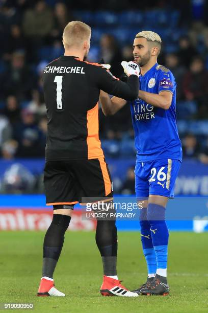 Leicester City's Danish goalkeeper Kasper Schmeichel and Leicester City's Algerian midfielder Riyad Mahrez interact before the English FA Cup fifth...
