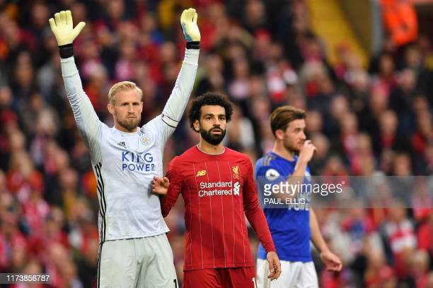 Leicester City's Danish goalkeeper Kasper Schmeichel and Liverpool's Egyptian midfielder Mohamed Salah gesture during the English Premier League...