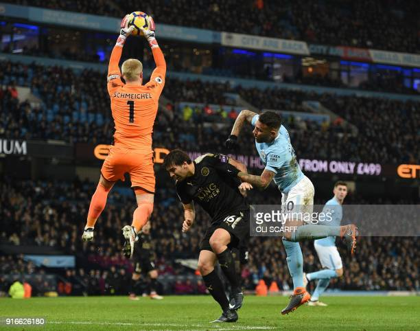 Leicester City's Danish goalkeeper Kasper Schmeichel catches the ball during the English Premier League football match between Manchester City and...