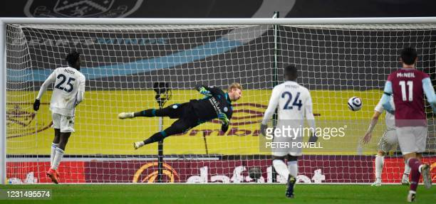 Leicester City's Danish goalkeeper Kasper Schmeichel dives to make a save during the English Premier League football match between Burnley and...