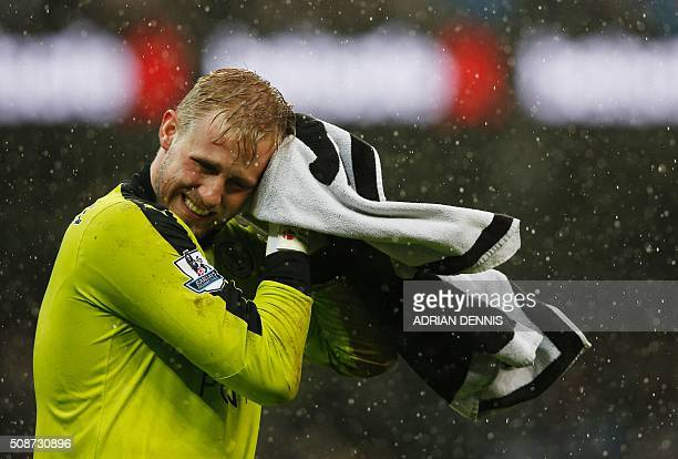 Leicester City's Danish goalkeeper Kasper Schmeichel dries his face with a towel during the English Premier League football match between Manchester...