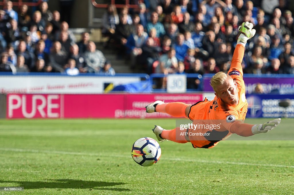 Leicester City's Danish goalkeeper Kasper Schmeichel is beaten by a shot from Huddersfield Town's English midfielder Tom Ince (not pictured) but the shot goes wide, during the English Premier League football match between Huddersfield Town and Leicester City at the John Smith's stadium in Huddersfield, northern England on September 16, 2017. / AFP PHOTO / Oli SCARFF / RESTRICTED TO EDITORIAL USE. No use with unauthorized audio, video, data, fixture lists, club/league logos or 'live' services. Online in-match use limited to 75 images, no video emulation. No use in betting, games or single club/league/player publications. /