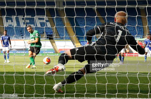 Leicester City's Danish goalkeeper Kasper Schmeichel jumps and saves a penalty hit by Brighton's French striker Neal Maupay during the English...
