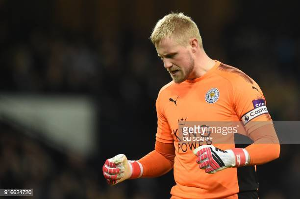 Leicester City's Danish goalkeeper Kasper Schmeichel reacts to a Manchester City miss during the English Premier League football match between...
