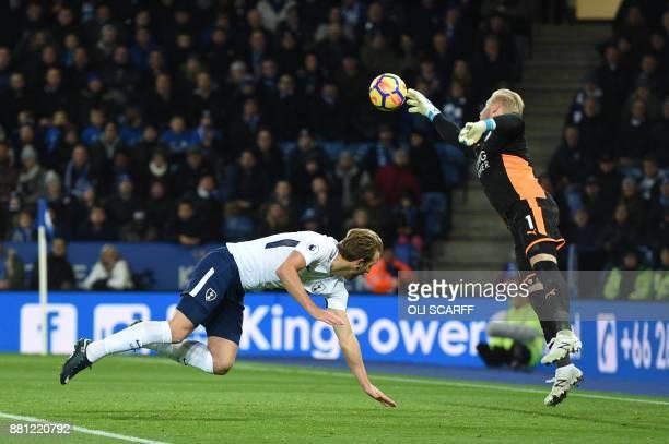 Leicester City's Danish goalkeeper Kasper Schmeichel saves a shot by Tottenham Hotspur's English striker Harry Kane during the English Premier League...