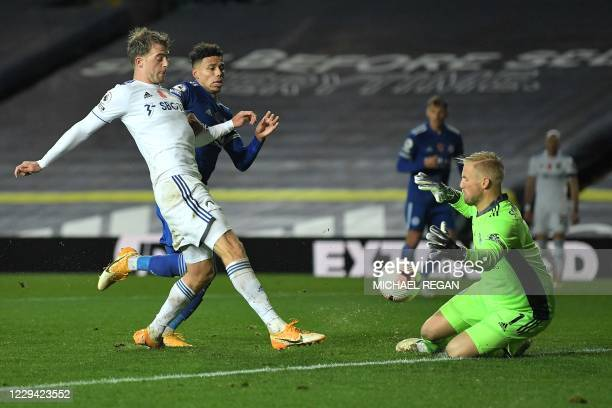 Leicester City's Danish goalkeeper Kasper Schmeichel saves a shot from Leeds United's English striker Patrick Bamford during the English Premier...