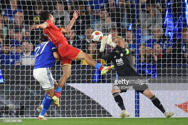 Leicester City's Danish goalkeeper Kasper Schmeichel saves a shot from Napoli's Mexican forward Hirving Lozano during the UEFA Europa League Group C...