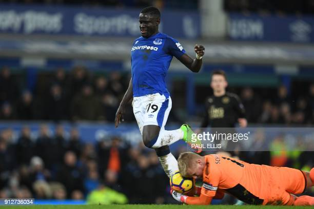 Leicester City's Danish goalkeeper Kasper Schmeichel saves at the feet of Everton's Senegalese striker Oumar Niasse during the English Premier League...