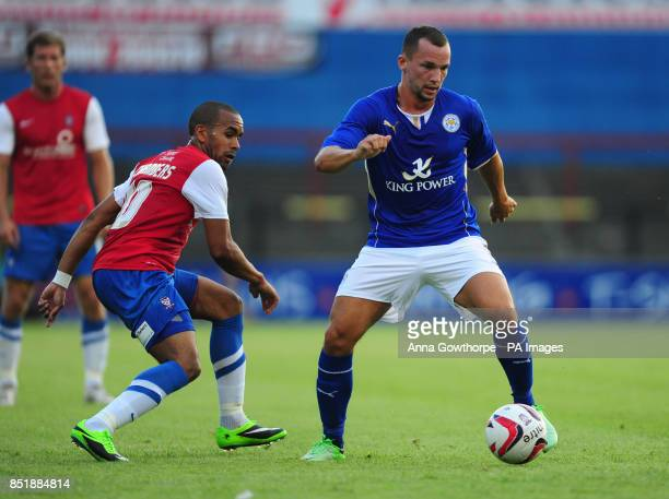 Leicester City's Danny Drinkwater in action with York City's Ashley Chambers during the preseason friendly at Bootham Crescent York