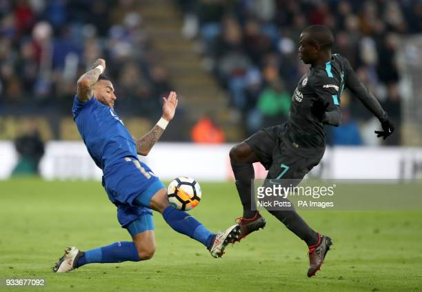Leicester City's Danny Simpson and Chelsea's N'Golo Kante battle for the ball during the Emirates FA Cup quarter final match at the King Power...