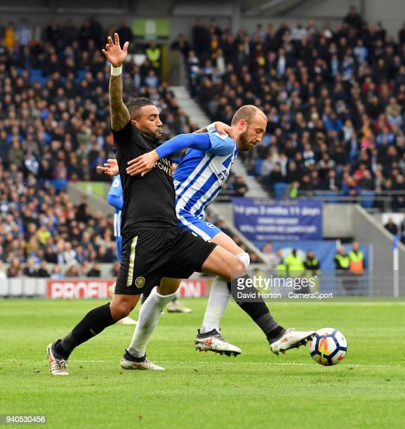Leicester City's Danny Simpson battles with Brighton Hove Albion's Glenn Murray during the Premier League match between Brighton and Hove Albion and...