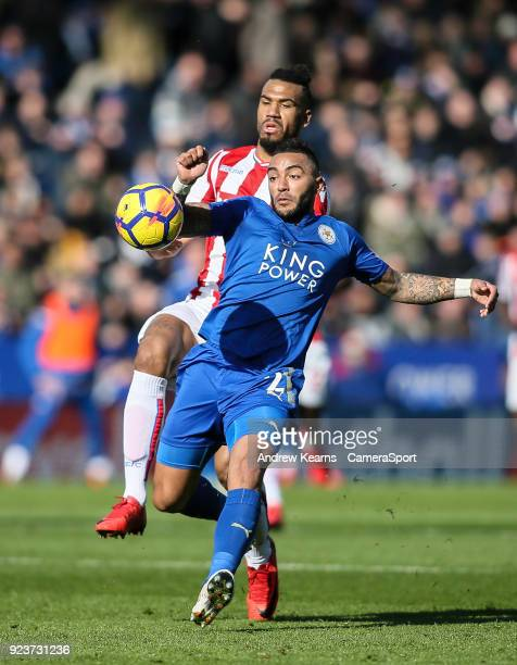 Leicester City's Danny Simpson beats Stoke City's Eric Maxim ChoupoMoting to the ball during the Premier League match between Leicester City and...