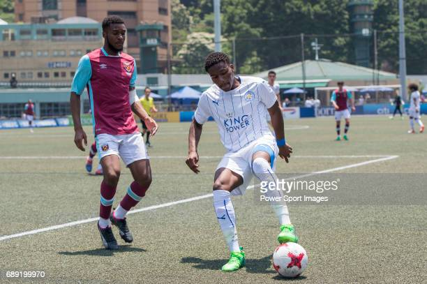 Leicester City's Darnell Johnson competes with West Ham United's Sam Ford for a ball during their Main Tournament Cup QuarterFinal match part of the...