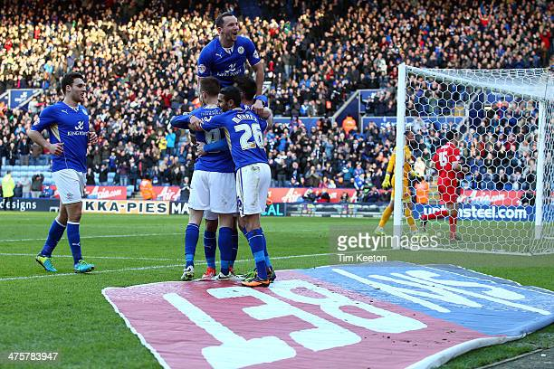 Leicester City's David Nugent is congratulated by Daniel Drinkwater and team mates on making it 30 during the Sky Bet Championship match between...