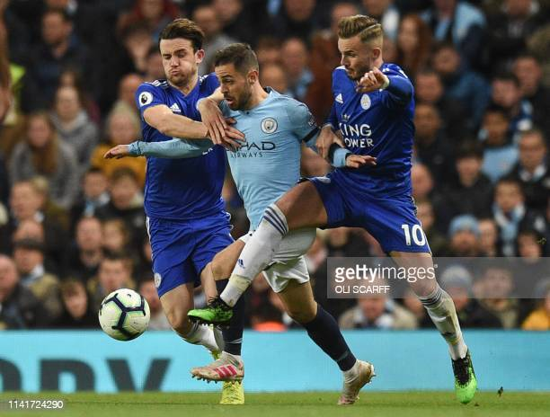 TOPSHOT Leicester City's English defender Ben Chilwell and Leicester City's English midfielder James Maddison challenge Manchester City's Portuguese...
