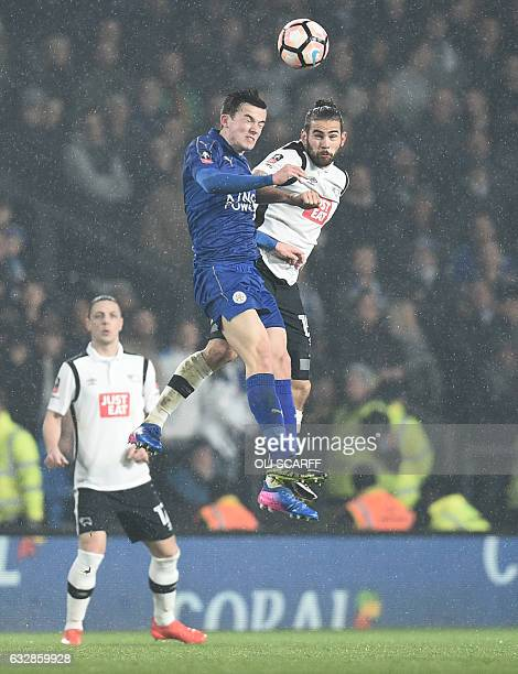 Leicester City's English defender Ben Chilwell vies with Derby's English midfielder Bradley Johnson during the English FA Cup fourth round football...