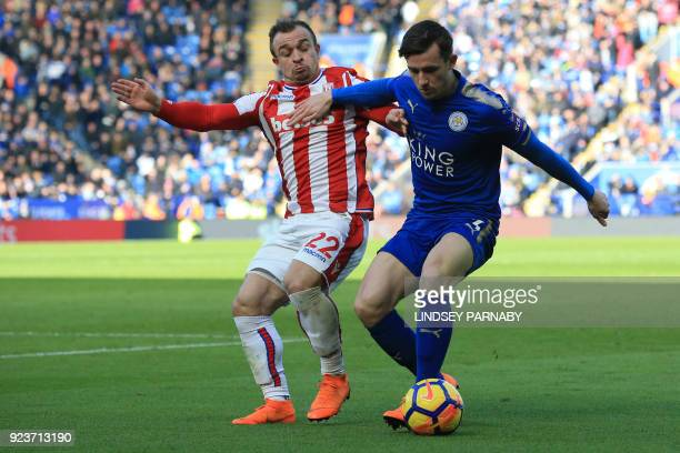 Leicester City's English defender Ben Chilwell vies with Stoke City's Swiss forward Xherdan Shaqiri during the English Premier League football match...