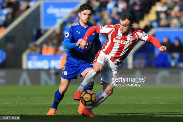 Leicester City's English defender Ben Chilwell vies with Stoke City's Swiss striker Xherdan Shaqiri during the English Premier League football match...
