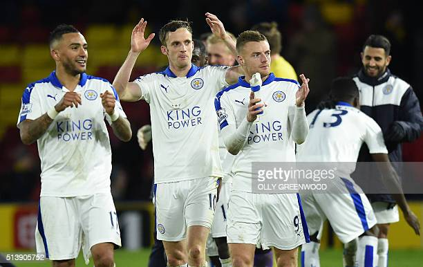 Leicester City's English defender Danny Simpson Leicester City's Welsh midfielder Andy King and Leicester City's English striker Jamie Vardy appluad...