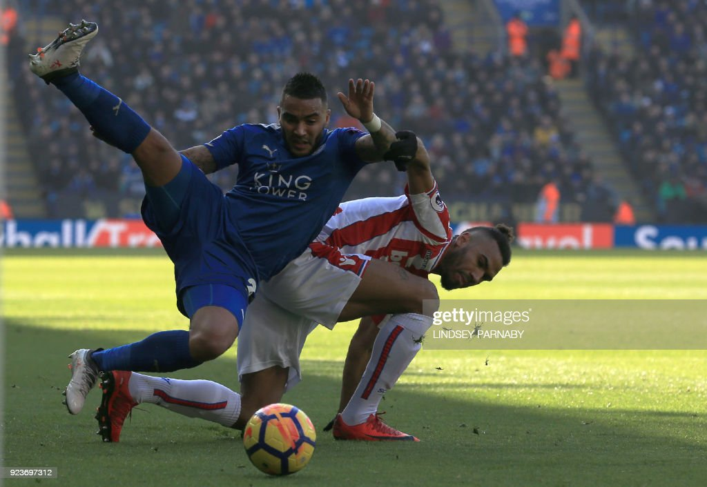 Leicester City's English defender Danny Simpson (L) vies with Stoke City's German midfielder Eric Maxim Choupo-Moting (R) during the English Premier League football match between Leicester City and Stoke City at King Power Stadium in Leicester, central England on February 24, 2018. / AFP PHOTO / Lindsey PARNABY / RESTRICTED TO EDITORIAL USE. No use with unauthorized audio, video, data, fixture lists, club/league logos or 'live' services. Online in-match use limited to 75 images, no video emulation. No use in betting, games or single club/league/player publications. /