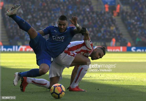 Leicester City's English defender Danny Simpson vies with Stoke City's German midfielder Eric Maxim ChoupoMoting during the English Premier League...