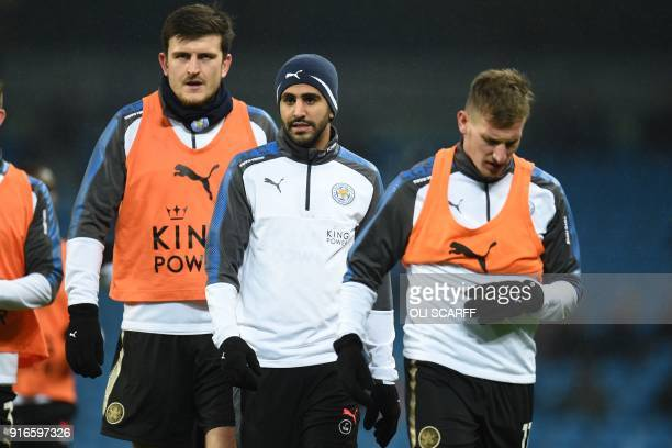 Leicester City's English defender Harry Maguire and Leicester City's Algerian midfielder Riyad Mahrez warm up ahead of the English Premier League...