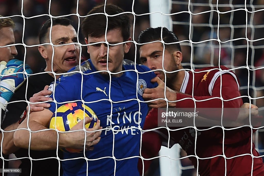 TOPSHOT - Leicester City's English defender Harry Maguire (C) and Liverpool's German midfielder Emre Can (R) fight for the ball after the second goal during the English Premier League football match between Liverpool and Leicester at Anfield in Liverpool, north west England on December 30, 2017. / AFP PHOTO / PAUL ELLIS / RESTRICTED TO EDITORIAL USE. No use with unauthorized audio, video, data, fixture lists, club/league logos or 'live' services. Online in-match use limited to 75 images, no video emulation. No use in betting, games or single club/league/player publications. /