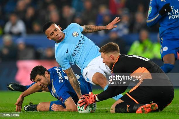 Leicester City's English defender Harry Maguire chases as Manchester City's Brazilian striker Gabriel Jesus runs through on goal but is stopped by...