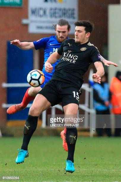 Leicester City's English defender Harry Maguire tries to hold off Peterborough United's English striker Jack Marriott during the English FA Cup...