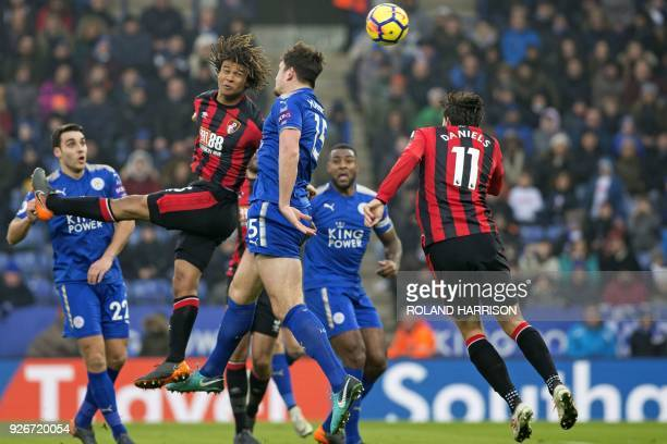 Leicester City's English defender Harry Maguire vies with Bournemouth's Dutch defender Nathan Ake and Bournemouth's English midfielder Charlie...