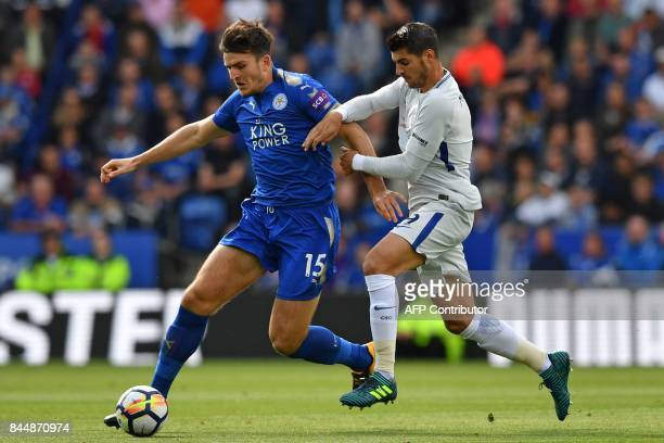 Leicester City's English defender Harry Maguire vies with Chelsea's Spanish striker Alvaro Morata during the English Premier League football match...