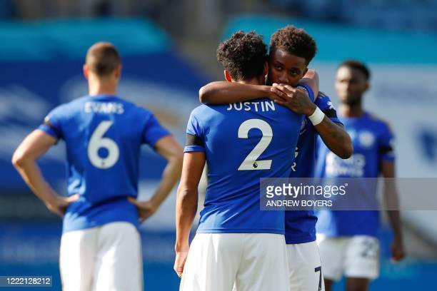 Leicester City's English defender James Justin and Leicester City's English midfielder Demarai Gray hug prior to the English Premier League football...