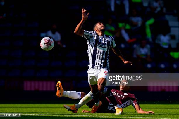 Leicester City's English defender James Justin fouls West Bromwich Albion's English defender Darnell Furlong on the edge of the penalty area during...