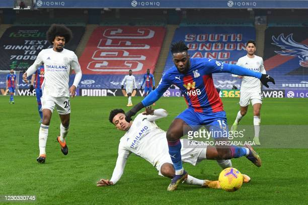 Leicester City's English defender James Justin tackles Crystal Palace's German midfielder Jeffrey Schlupp during the English Premier League football...